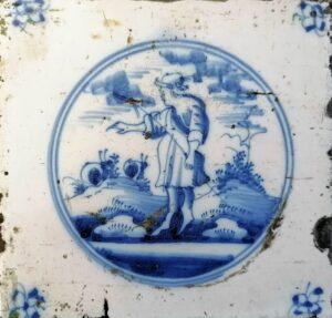 Fliza pasterska, przedsawienie wpisane wpodwójny medalion, ornament narożnikowy typu pająk, Amstardam Ip. XVIII w.
