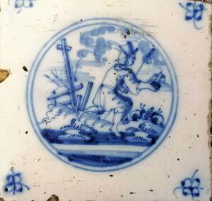 Fliza pasterska, przedstawienie wpisane wpodwójny medalion, ornament narożnikowy typu pająk, Amstardam Ip. XVIII w.