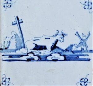 Fliza pejzażowa zbykiem iwiatrakiem wtle, ornament narożnikowy typu pająk, Amsterdam Ip. XVIII w.