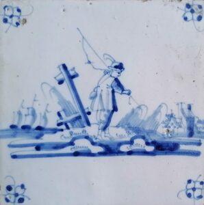 Fliza pejzażowa zrybakiem, ornament narożnikowy typu pająk, Amsterdam Ip. XVIII w.