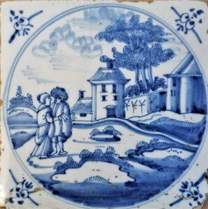 Pejzaż zparą natle zabudowań, przedstawienie wpisane wpodwójny medalion, ornament narożnikowy wola główka, Amstardam Ip.XVIII w.
