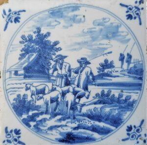 Pejzaż zparą pasterzy, przedstawienie wpisane wpodwójny medalion, ornament narożnikowy wola główka, Amstardam Ip.XVIII w.