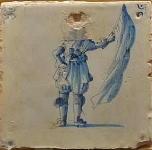 Żołnierz zflagą, ornament narożnikowy typu wola główka, XVII w. (2)