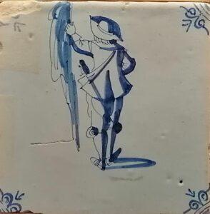 Żołnierz zflagą, ornament narożnikowy typu wola główka, XVII w.